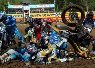 In this photo provided by AMA Pro Racing, Tanner Reidman (733), of Bismarck, N.D., Brett Metcalfe (123), of Australia, and Ryan Sipes (yellow helmet), of Vine Grove, Ky., are among a group of riders to go down in a pileup crash Sunday in the first turn of the AMA 125cc Motocross Championship round in Millville, Minn. None of the riders suffered major injuries in the crash. Reidman, Metcalfe and Sipes all re-entered the race. (AP Photo/AMA Pro Racing, Larry Lawrence)