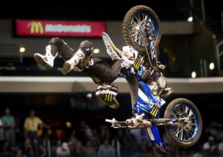 Taka Higashino performs a rock solid backflip on his first run during Moto X Freestyle Final during X Games Los Angeles inside the Staples Center in downtown Los Angeles on Thursday, June 28, 2012. Higashino won first place. (SGVN/Staff photo by Watchara Phomicinda)